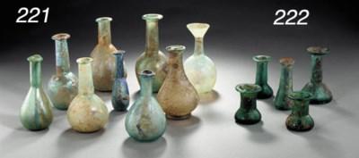 NINE ROMAN GLASS VESSELS