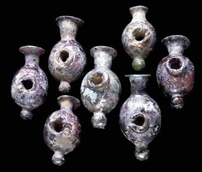 SEVEN ROMAN GLASS OBJECTS