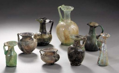 EIGHT ROMAN GLASS VESSELS