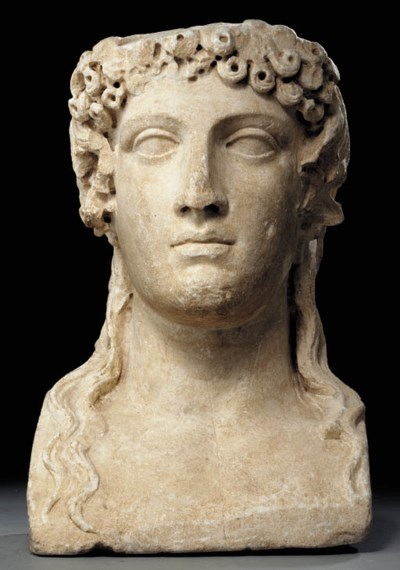 A ROMAN MARBLE HEAD OF APOLLO