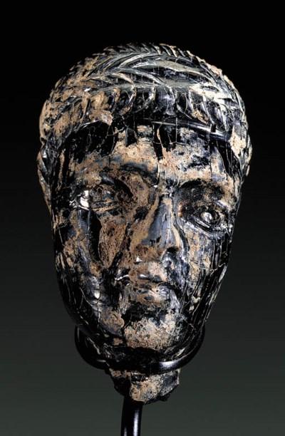 A LATE ROMAN JET HEAD OF A MAN