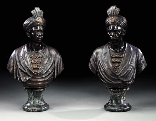 A pair of bronze-patinated cop