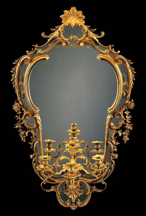 A Louis XV style ormolu four-l