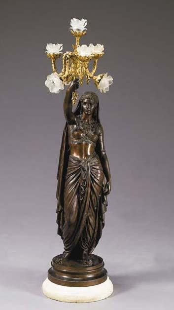 A French ormolu and bronze fig