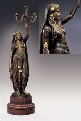 A French bronze, parcel-gilt a