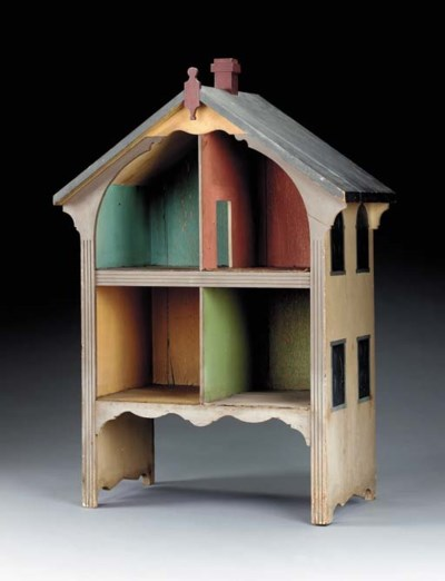 A PAINTED WOOD DOLL HOUSE