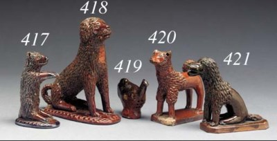 A REDWARE SEATED DOG