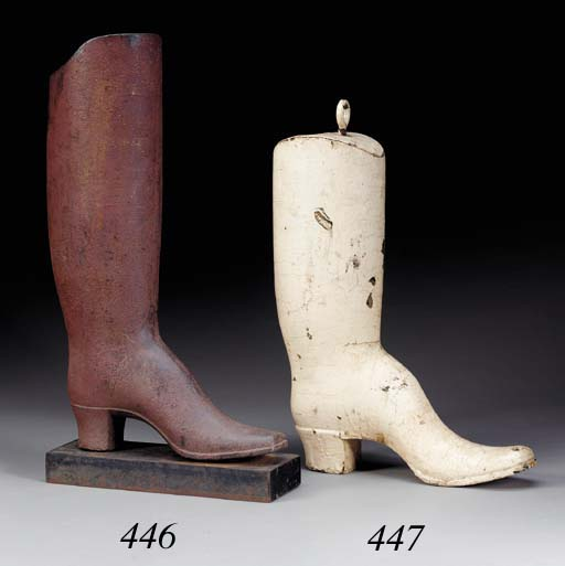 A CARVED AND PAINTED COBBLER'S