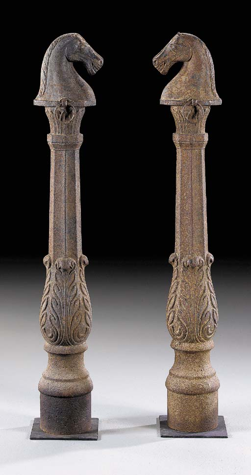 A PAIR OF CAST-IRON HORSE-HEAD HITCHING POSTS