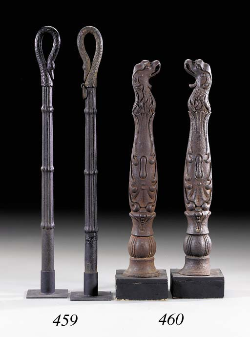 A PAIR OF BLACK-PAINTED CAST-IRON HITCHING POSTS