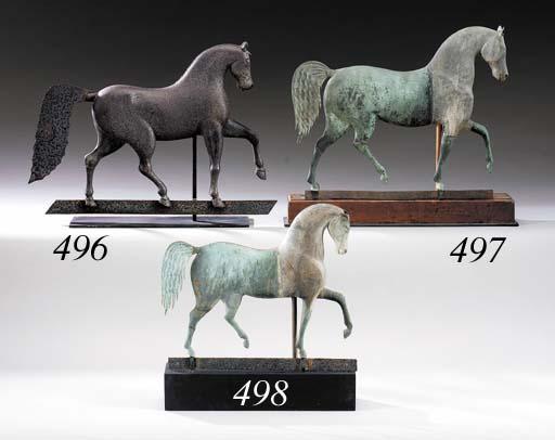 A CAST IRON HORSE WEATHERVANE