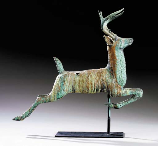 A MOLDED COPPER LEAPING STAG W