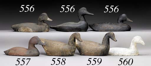 A PAINTED CAST-IRON SINK DUCK