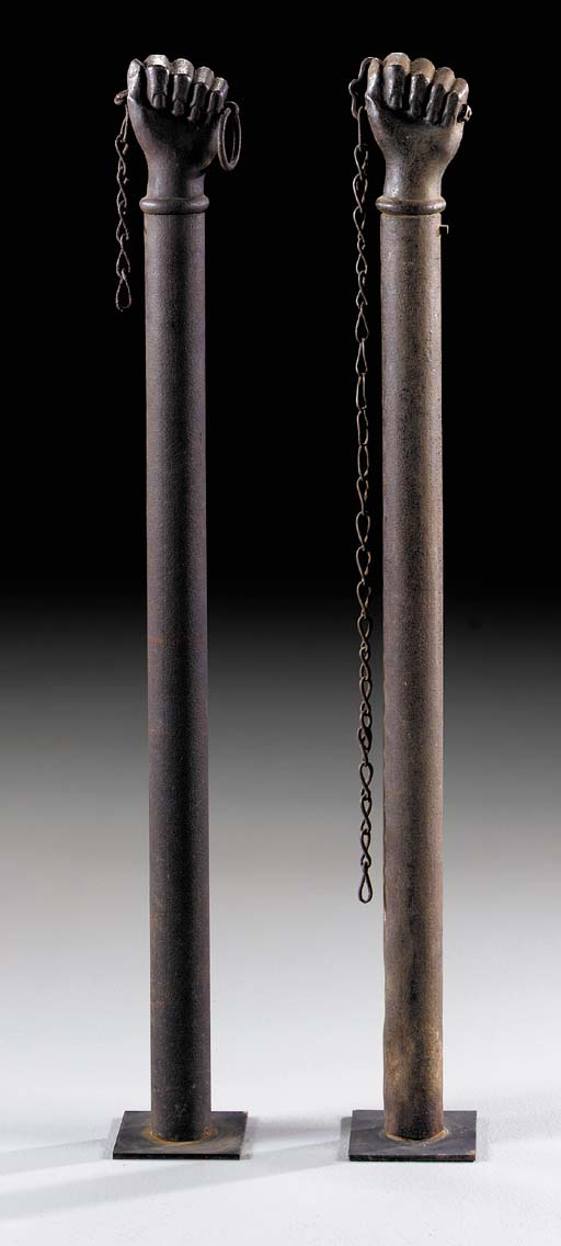 A PAIR OF CAST-IRON HITCHING P