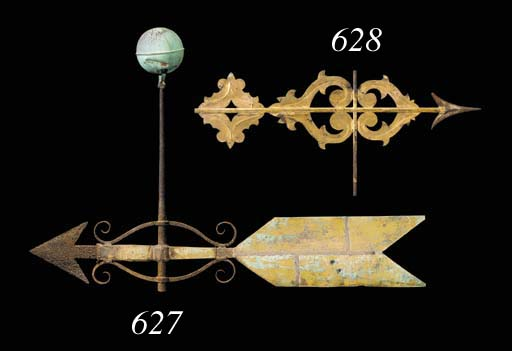 A WROUGHT IRON AND GILDED COPP