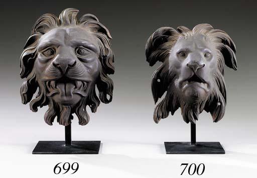 A CAST-IRON LION'S-HEAD ARCHIT