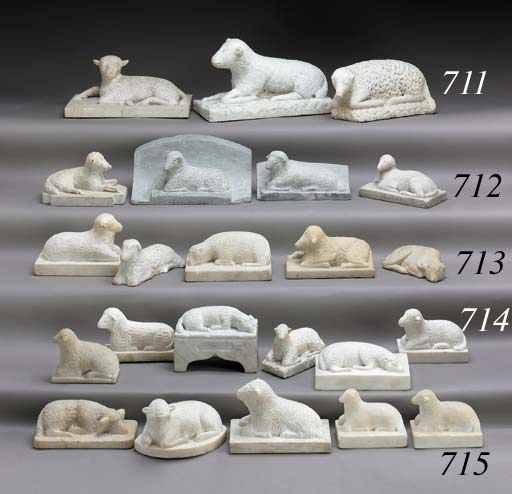 A GROUP OF SIX CARVED MARBLE L
