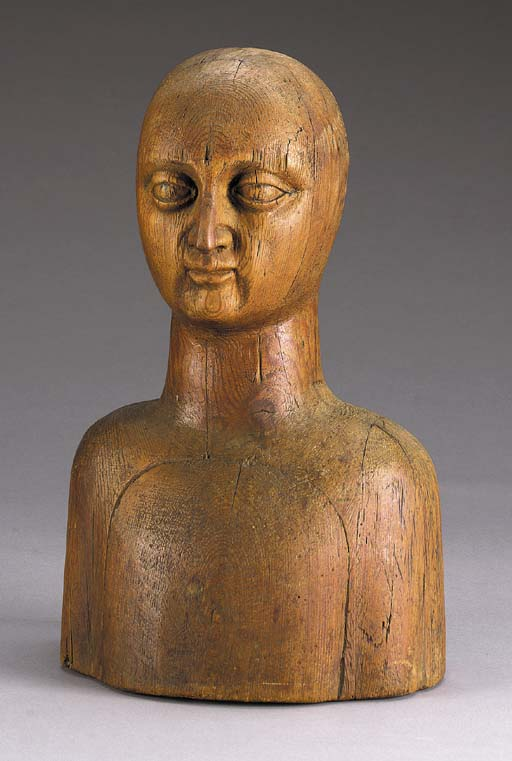 A CARVED WOOD BUST STORE DISPL