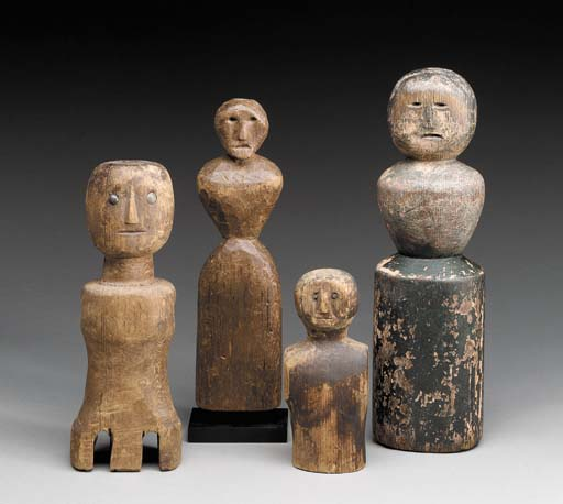 A GROUP OF FIVE CARVED WOOD PR