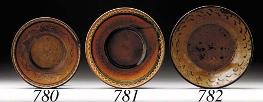 A SLIP-DECORATED REDWARE BOWL