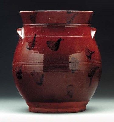 A GLAZED REDWARE JAR