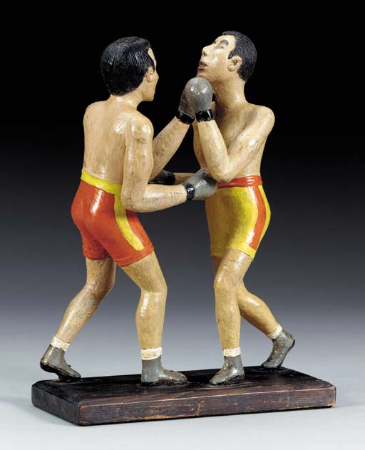 A CARVED AND PAINTED FIGURAL G