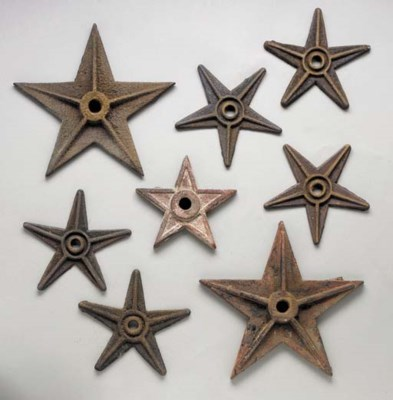 A GROUP OF EIGHT CAST-METAL ST