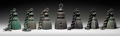 A GROUP OF SEVEN CAST-IRON TAS