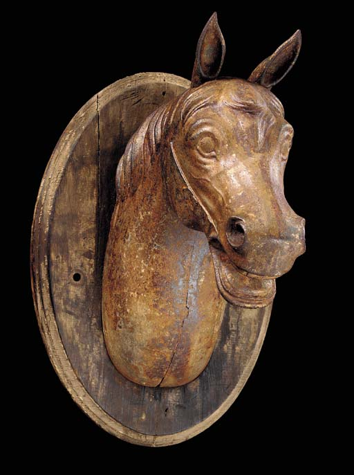 A PAINTED CAST-IRON HORSE-HEAD