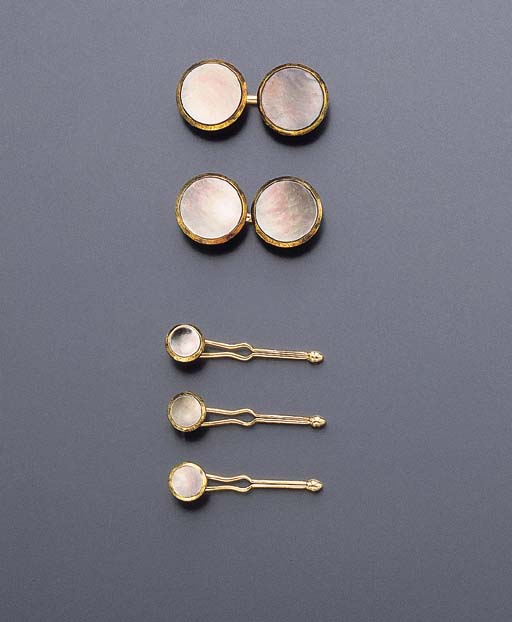 A MOTHER-OF-PEARL DRESS-SET