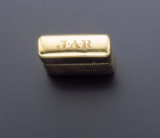 A GOLD CIGARETTE LIGHTER, BY T