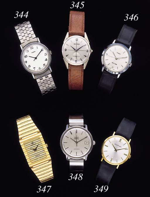 Timex. A base metal and stainless steel wristwatch with sweep center seconds