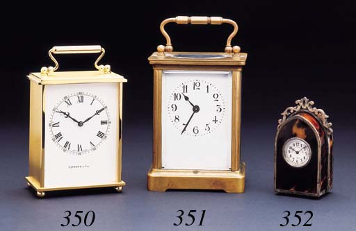 Swiss. A gilt carriage clock with presentation inscription