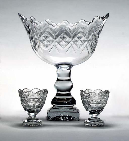 A NAVETTE-SHAPED CUT GLASS CEN