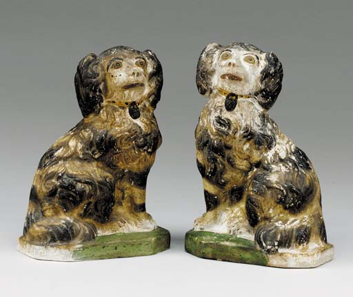 A PAIR OF MOLDED FIGURAL CHALK