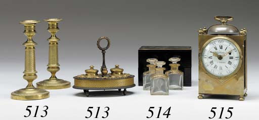 A PAIR OF EMPIRE BRASS CANDLES