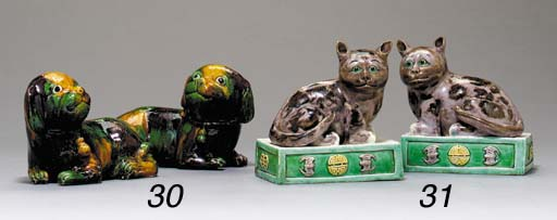 A PAIR OF BISCUIT-GLAZED CATS