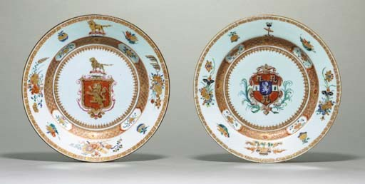 TWO IRON-RED AND GILT ARMORIAL