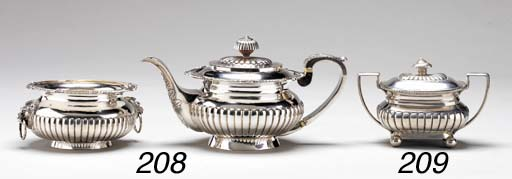 A GEORGIAN STYLE TEAPOT AND CO