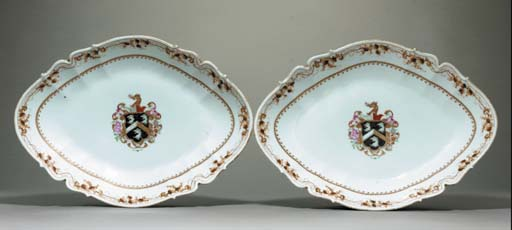 A LARGE PAIR OF ARMORIAL FOOTE