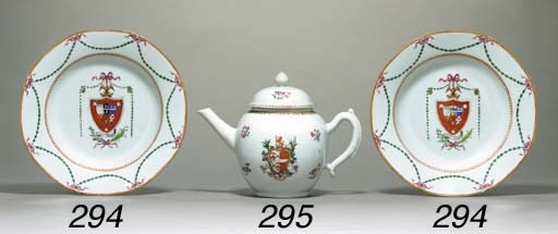 AN ARMORIAL TEAPOT AND COVER