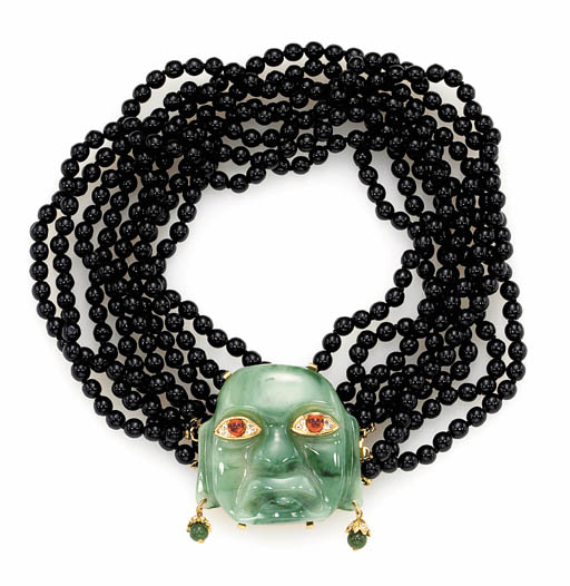 A SIMULATED BLACK ONYX BEAD AN