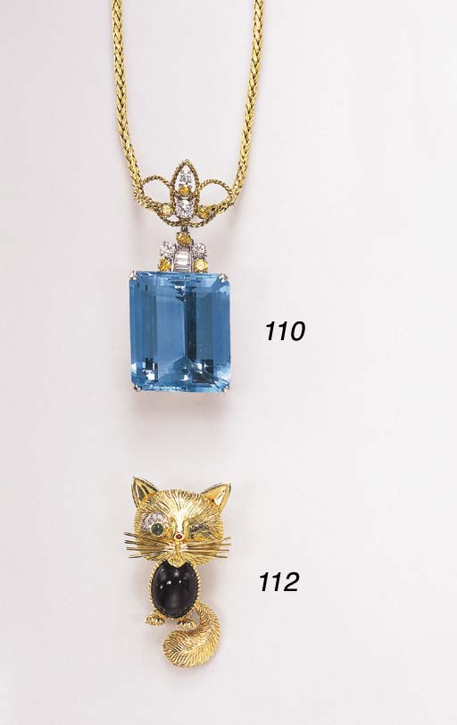 AN ONYX, EMERALD AND RUBY CAT