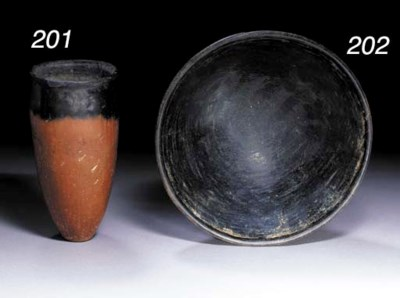 AN EGYPTIAN POTTERY BOWL