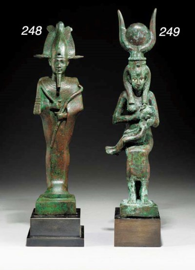 AN EGYPTIAN BRONZE FIGURE OF I