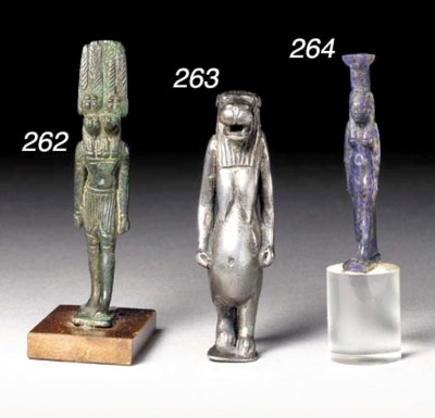 AN EGYPTIAN LAPIS FIGURE OF NE