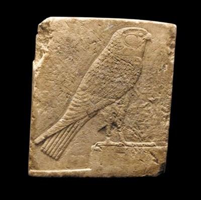 AN EGYPTIAN LIMESTONE SCULPTOR