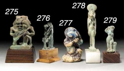 AN EGYPTIAN FAIENCE BES-FORM V