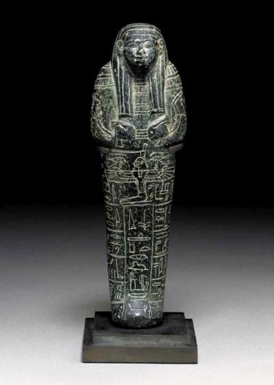 AN EGYPTIAN SERPENTINE SHABTI