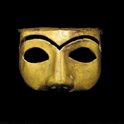 A WESTERN ASIATIC GOLD MASK